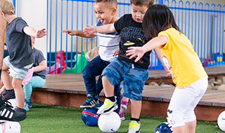 Children Learning Soccer